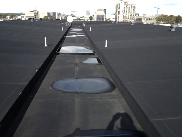 Pre-construction - Delamination of roof parapet cladding