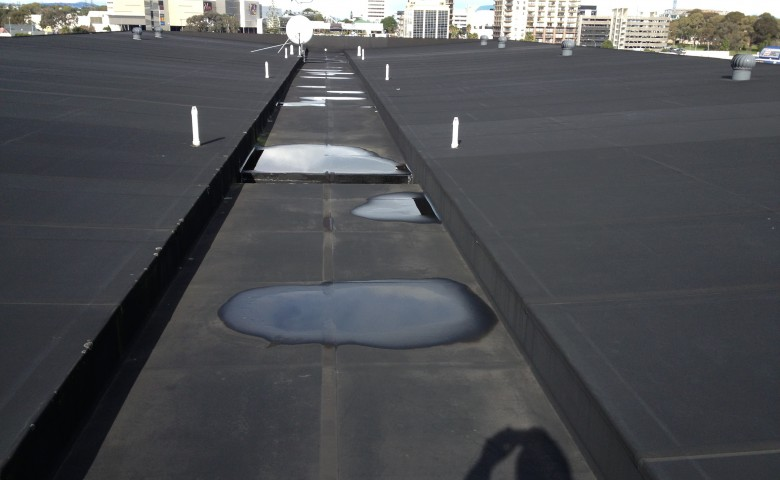 pre construction delamination on roof parapet cladding