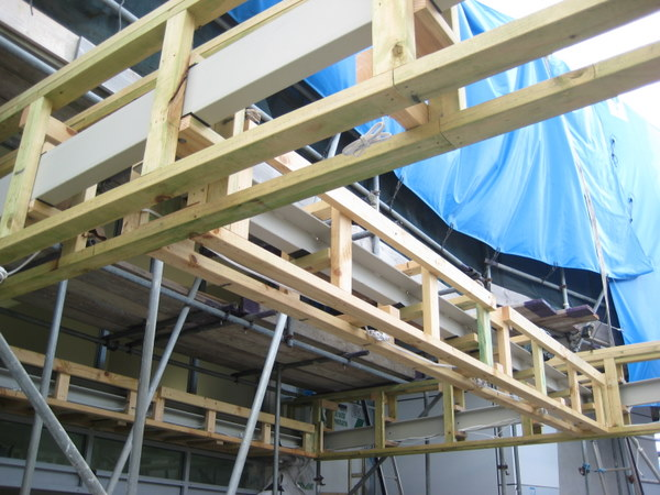 Cutters cover construction remediation underway with scaffolding and wooden frames