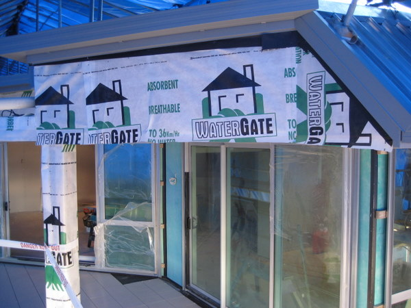 house wrap during cutters cove's full construction remediation process