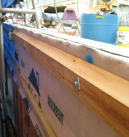 Closeup on cutters cove weather tight improvements using absorbent house wrap
