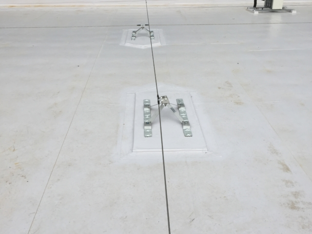 South - Roof overlay panel system (Rooflogic).  Tidy layout of HVAC units and penetrations