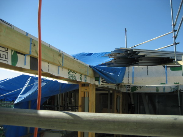 IPMS construction progress to make cutters cove appartments weather tight