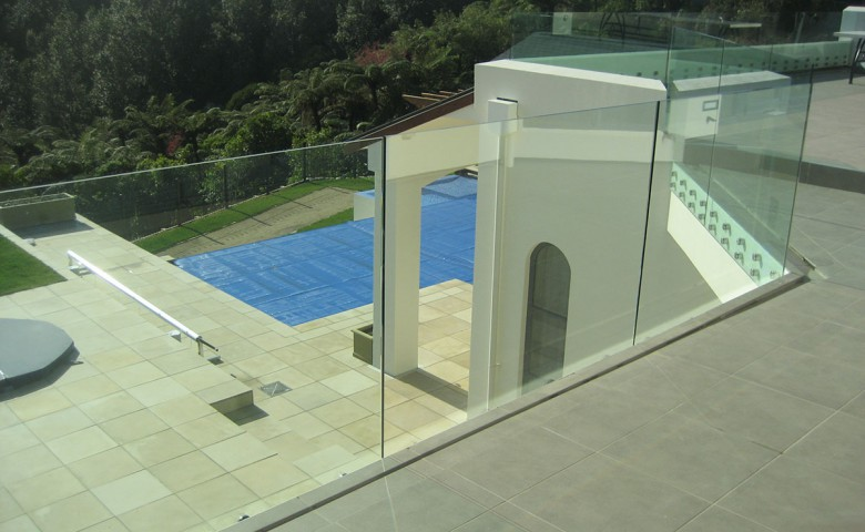 glass balcony view of new dwellings swimming pool and spa area