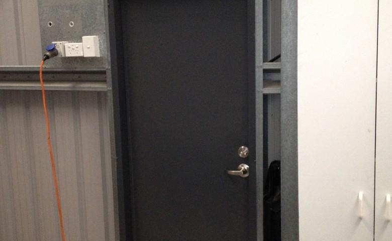 black door on new engineering workshop at McFall Museum